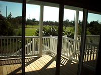 View from the porch of a typical key west golf club home, overlooking the key west golf course